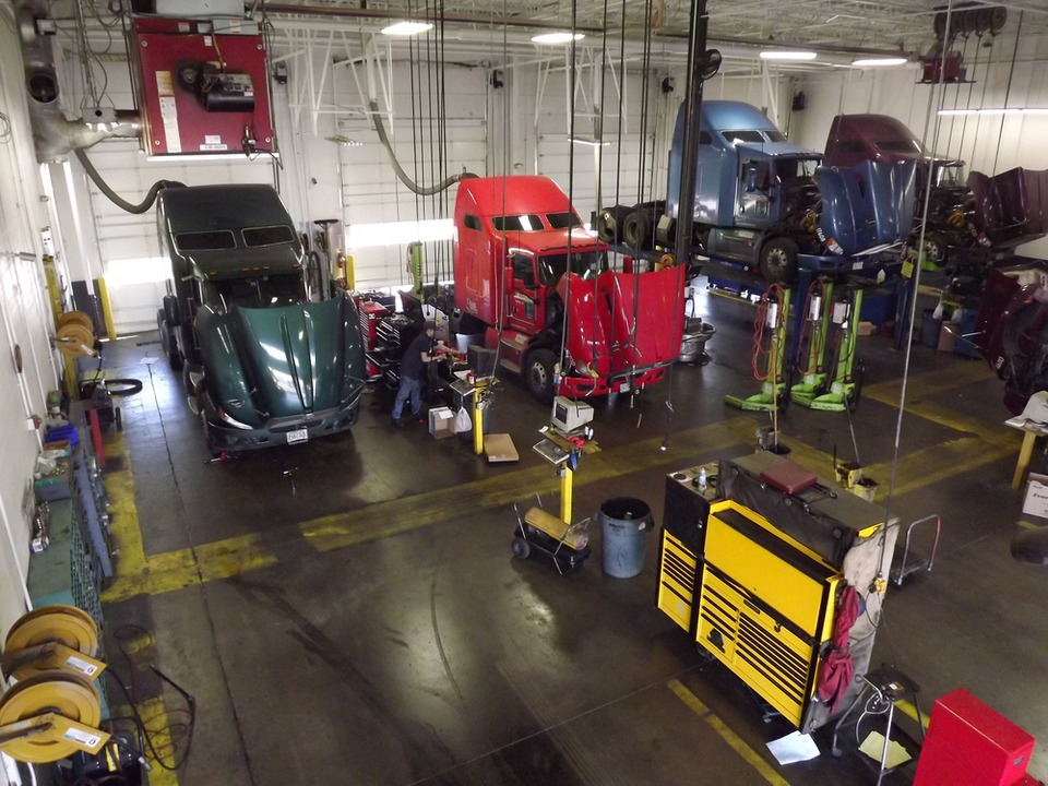 Why Organize Truck Repair Shops For Safety - Mechanic shop flooring