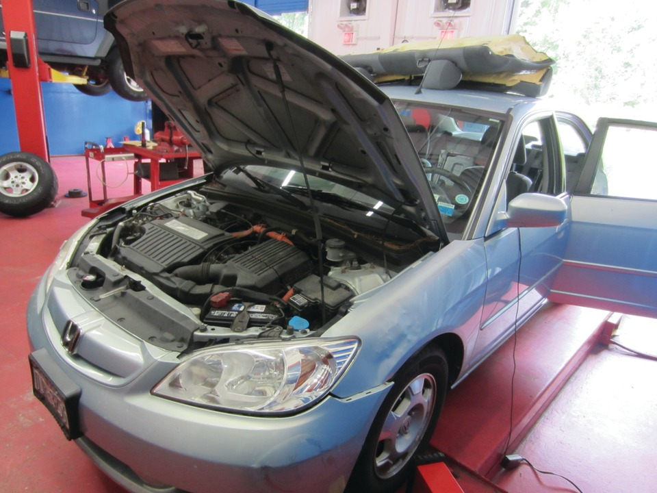 This 2005 Honda Civic Hybrid Has An Ima Light On In Order To Access The Hv Battery Rear Seat Be Removed Show Caption Hide