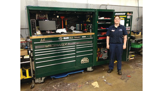 Girls dig green toolboxes