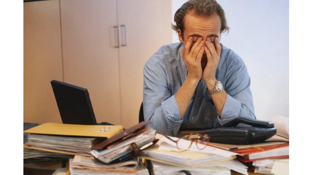 frustrated-mgr-at-desk_11574240.psd